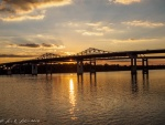 The sun sets on the bridge